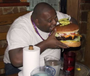 guy-eating-giant-hamburger